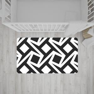 שטיח בהדפס גיאומטרי בצבעי שחור-לבן